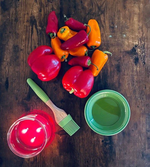 sweet and hot peppers, candle, olive oil