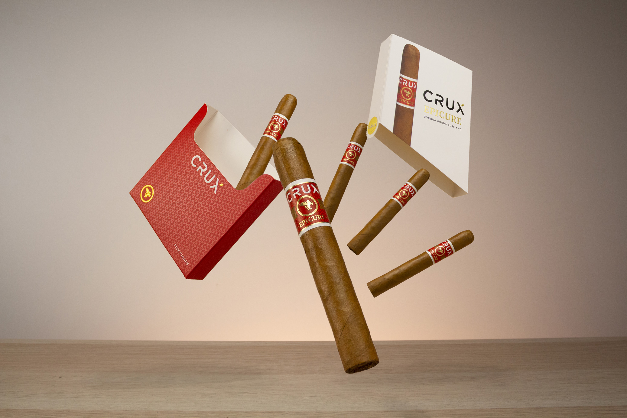 red box and white box of crux cigar packs falling