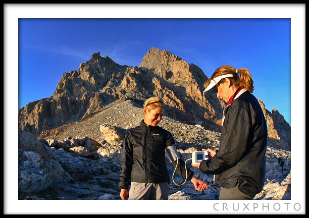 Checking Kelly Perkins' Blood Pressure at 11,610 feet at the lower Saddle.  Copyright Nate Young and Crux Photo.
