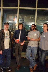 Cruzio staffers Colin, Alex, Dave and Ali take kick back and enjoy the night