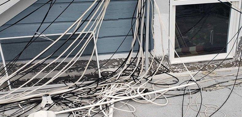 spaghetti-ike phone wiring around a window