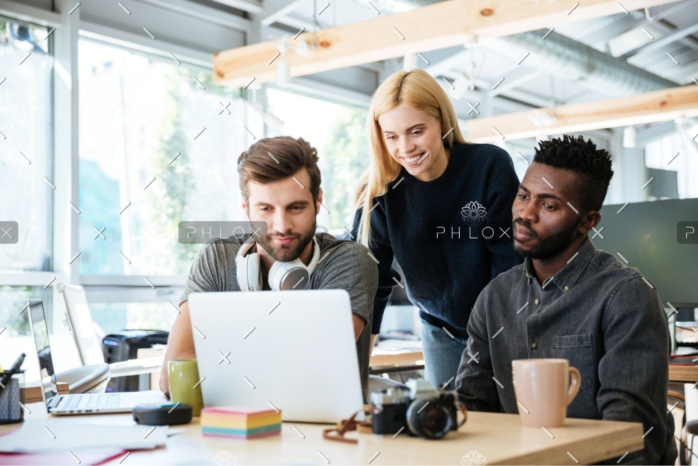 demo-attachment-335-happy-colleagues-sitting-in-office-coworking-PHYA6TG