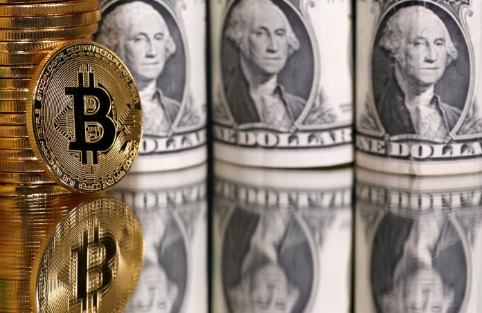 FILE PHOTO: Representations of bitcoin and U.S. dollar banknotes are seen in this illustration taken January 6, 2020. REUTERS/Dado Ruvic/Illustration/File Photo