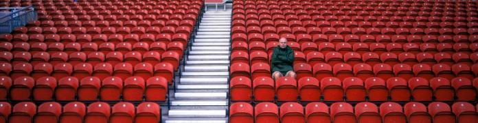 Man in Empty Stadium