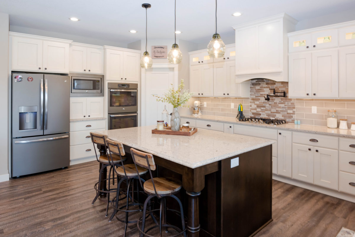 Antique Ivory Kitchen With A Contrasting Island Crystal Cabinets