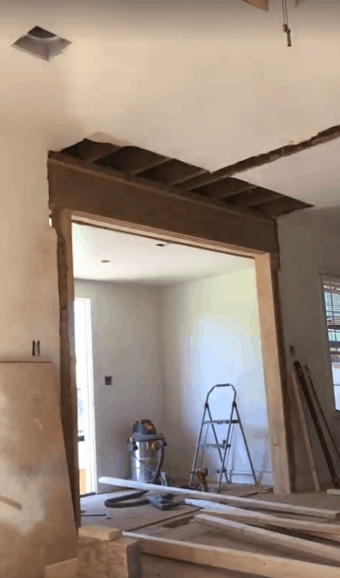 newly opened up entryway with beam installed looking from living area