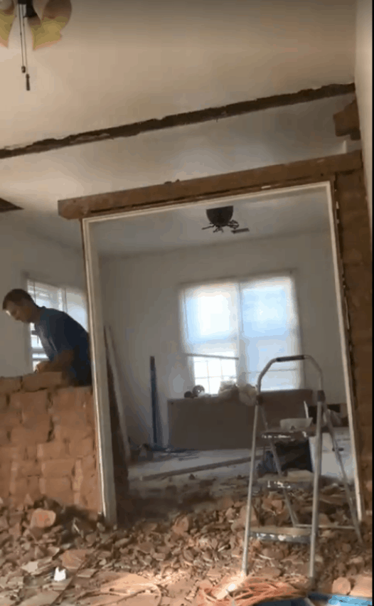 exposed brick on inside living area wall that is being removed between two rooms