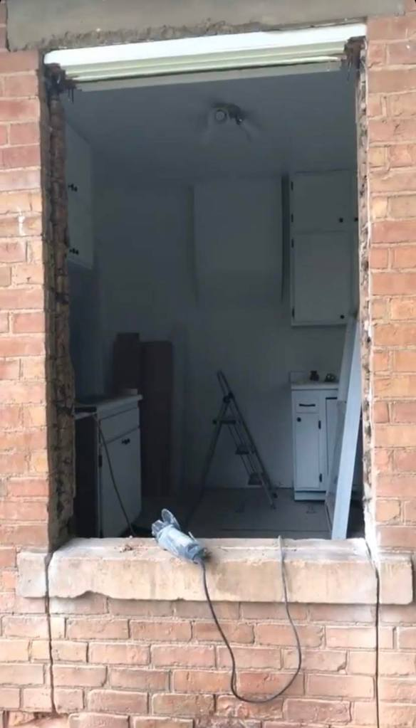 View into the kitchen after window was removed and before brick underneath was taken out