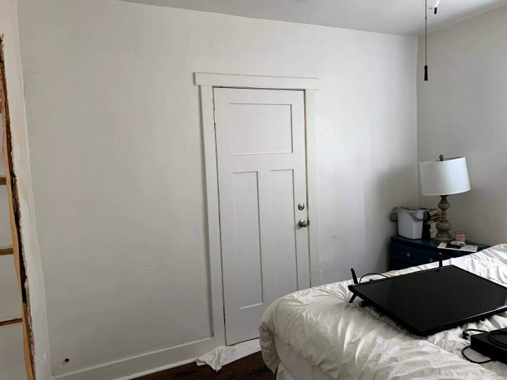 Before photo of wall with door