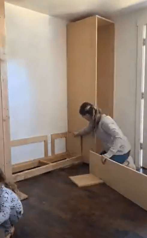 Me adding a piece of MDF to build the side of my bench carcass