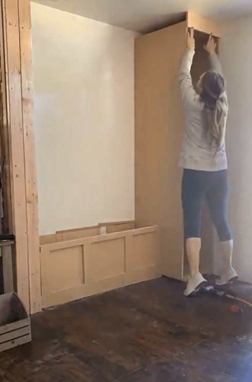 Me adding the upper face plate to the tall cabinet carcass