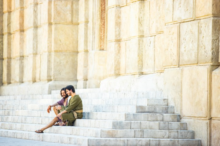 Jesus The Chosen one and His disciple sitting on the stone steps of the temple