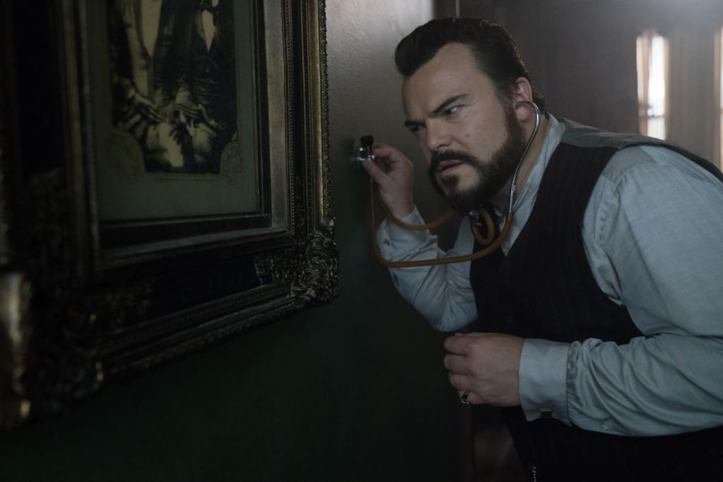 jack black house with a clock in its walls small 1613116359801