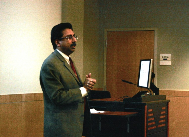 Dr. Gopal Gupta welcoming attendees to the first lecture of the Grace Series.