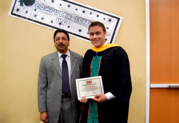 Robert Farmigoni accepting the inaugural Doctor Family Award from Dr. Gupta.