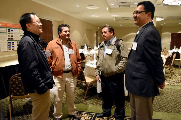 Dr. Xiaohu Guo, founding member of UT-DIISC (Left), talking with Drs. Raúl Enrique Sánchez Yañez, and Victor Ayala Ramirez from the University De Guanajuato, and Dr. B. Prabhakaran, a founding member of UT-DIISC.