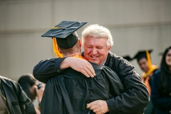 William Lovell gives an emotional embrace to Jeremy Pierce, who graduated with a bachelorís degree in software engineering. Lovell is Jeremyís pastor and supported Jeremy through the difficult time of losing his father to cancer.