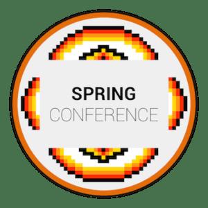 Orange circle insde orange and black tribal symbol Spring Conference