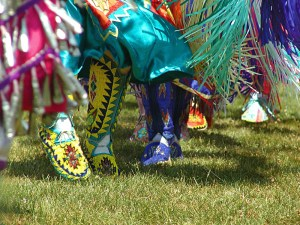 Colorful dresses and shoes dancing on grass