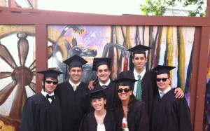 A picture of the class of 2012 on graduation day. Back, left to right: Andrew Bennett, Joey Brown, David Margolies, Charles Gould, Mike White Front (left to right): Camille Cobb, Anna Pobletts