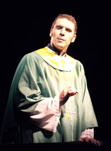 """Father Flynn, played by Mason Quinn, senior of Cheyenne, Wyo., delivers a sermon during the play """"Doubt.""""  — photo by Kinley Q. Nichols"""