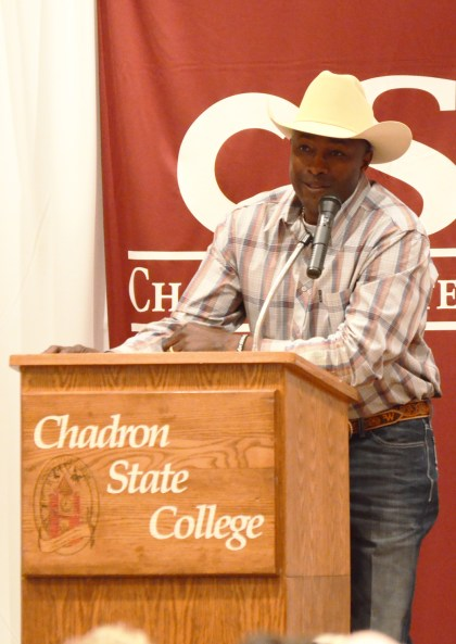 Fred Whitfield, eigth-time world champion roper, speaks to the audience during his presentation Thursday in the Student Center Ballroom. —Photo by Teri Robinson