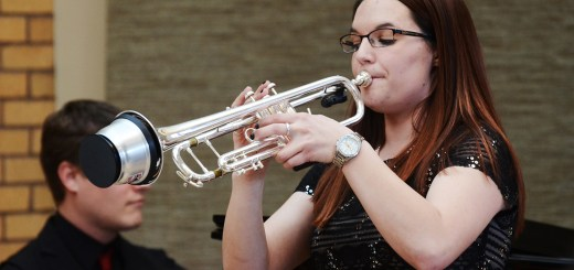 Jerica Rabenberg, senior of Dickinson, North Dakota, plays her trumpet with a mute, Saturday, during her senior recital at the Mari Sandoz High Plains Heritage Center Chicoine Atrium. —Photo by Teri Robinson