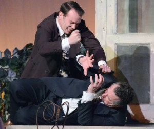 """Chris Keller, played by Colton Swibold, tries to punch his father Joe Keller, played by Mike Boland, when he learns the truth about him during """"All My Sons,"""" on Feb. 10 in Memorial Hall. —Photo by Sara Tweet"""
