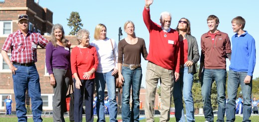 Larry Lytle, waving, and his family of Rapid City, South Dakota, are recognized as the 2016 Family Tree Award recipients Saturday during halftime of the Homecoming football game at Elliott Field. —Photo by Jordyn Hulinsky
