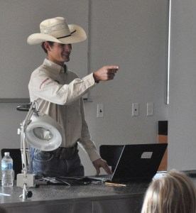 Dakota Rice, 22, senior of Kellogg, Idaho, answers agriculture questions Monday, during a western education program for middle school students.