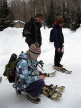 Cassidy, Maxim, and Matt put on their snowshoes.