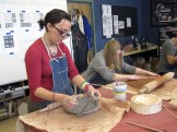 Miranda and Jennie roll out clay for their pottery.