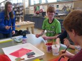 Amelia, Nate, and Liam working on their paste printing.