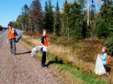 Highway cleanup on a bright afternoon