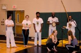 "Hattie and Sara prepare to play a game of Capoeira in the ""roda"": the circle in which music and martial arts conjoin."