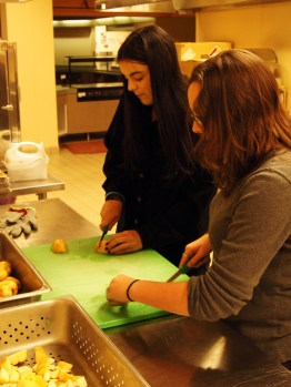 Sophia and Kate slice potatoes for the feast