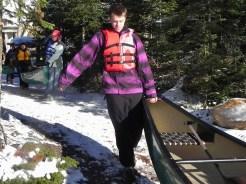 Max helps lift a canoe