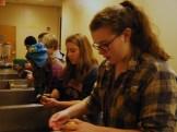 Ellie and Katelynn lead the potato peeling crew