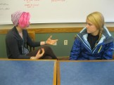 Emily tries to keep a straight face during discussion with Analeise to see how important questioning is.