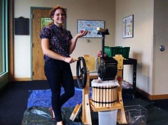 Grad Fellow Rebecca shows off the new apple press