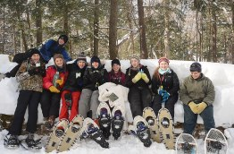 Nate, Bridger, Antonia, Marina, Abby, Sarah, Erica, Natalie, and Jake enjoy a break from snowshoeing in Sylvania