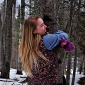 Maddy hugs a tree during the photography workshop