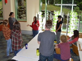 Melissa teaching students how to care for the indoor tower gardens