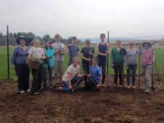 The group helping with Northland Pines Farm-to-School garden