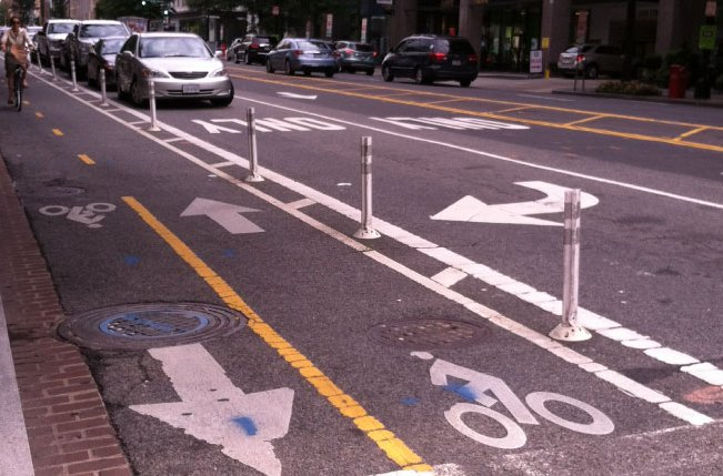 Protected bike lanes support alternative forms of transportation and healthy lifestyles. Photo: courtesy of Denise Nelson