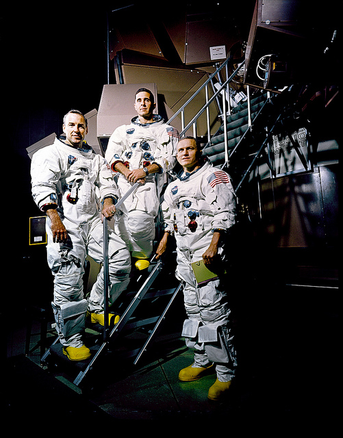 Apollo 8 crew is photographed posing on a Kennedy Space Center (KSC) simulator in their space suits. From left to right are: James A. Lovell Jr., William A. Anders, and Frank Borman. November 22, 1968 (NASA on the Commons)