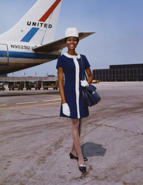 United Air Lines stewardess in uniform by Jean Louis 1968 Photo credit: United Airlines Archive