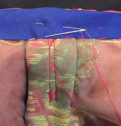 Hand stitching bias tape at waist