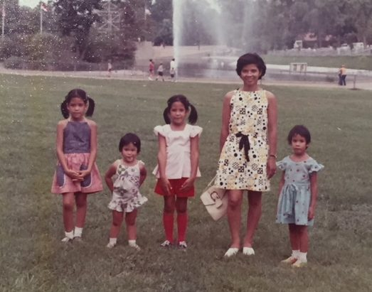 My mom, my sisters and I wearing clothes my mom made.