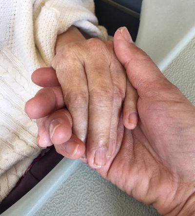 Mom's hand in mine - CSews.com